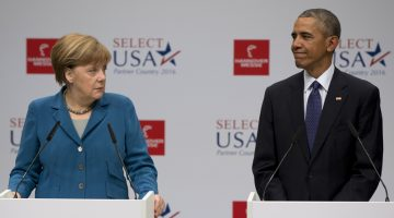 U.S. President Barack Obama and GermanВChancellor Angela Merkel look to each other as they speak before their tour of the Hannover Messe Trade Fair, the world's largest industrial technology trade fair, in Hannover, northern Germany, Monday April 25, 2016. Obama is on a two-day official visit to Germany. (AP Photo/Carolyn Kaster)