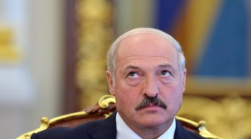 Belarussian President Alexander Lukashenko reacts on June 18, 2013 during his meeting with his Ukrainian counterpart in Kiev. Lukashenko started a two-day, official visit to Ukraine. AFP PHOTO/ SERGEI SUPINSKY