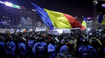 Protesters wave a Romanian flag during a demonstration in Bucharest, Romania, February 1, 2017. Inquam Photos/Octav Ganea via REUTERS ATTENTION EDITORS - THIS IMAGE WAS PROVIDED BY A THIRD PARTY. EDITORIAL USE ONLY. ROMANIA OUT. NO COMMERCIAL OR EDITORIAL SALES IN ROMANIA.