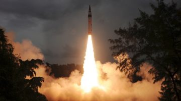 A surface-to-surface Agni-V missile is launched from the Wheeler Island off the eastern Indian state of Odisha September 15, 2013. India successfully test-fired for a second time a nuclear-capable missile on Sunday that can reach Beijing and much of Europe, bringing a step closer production of a weapon designed to strengthen its nuclear deterrent. REUTERS/Indian Defence Research and Development Organisation/Handout (INDIA - Tags: SCIENCE TECHNOLOGY MILITARY POLITICS TPX IMAGES OF THE DAY) ATTENTION EDITORS - THIS IMAGE WAS PROVIDED BY A THIRD PARTY. FOR EDITORIAL USE ONLY. NOT FOR SALE FOR MARKETING OR ADVERTISING CAMPAIGNS. THIS PICTURE IS DISTRIBUTED EXACTLY AS RECEIVED BY REUTERS, AS A SERVICE TO CLIENTS - RTX13LY1