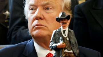 U.S. President Donald Trump receives a figurine of a sheriff during a meeting with county sheriffs at the White House in Washington, U.S. February 7, 2017.  REUTERS/Kevin Lamarque