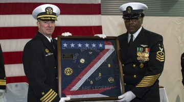 170203-N-AX638-335  NEWPORT NEWS, Va. (Feb. 3, 2017) Capt. Todd A. Beltz, commanding officer, USS Enterprise (CVN 65), and Command Master Chief Dwayne Huff pose with the commissioning pennant during the Enterprise decommissioning ceremony. Enterprise was decommissioned at Newport News Shipbuilding after 55 years of commissioned service. Enterprise deployed 25 times during its operational career and is the first nuclear powered aircraft carrier decommissioned by the Navy. (U.S. Navy photo by Mass Communication Specialist 2nd Class Tyler Preston/Released)