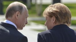 May 10, 2015 - Moscow, Russia - Angela Merkel, the Chancellor of Germany and Vladimir Putin, the President of Russia, walk away after the laying wreath ceremony at the Tomb of the Unknown Soldier, a day after the 70th Anniversary of Victory in the Great Patriotic War of 1941-1945. Alexander Garden (Aleksandrovsky Sad), Moscow, Russia, on May 10, 2015. (Credit Image: В© Artur Widak/NurPhoto/ZUMA Wire)