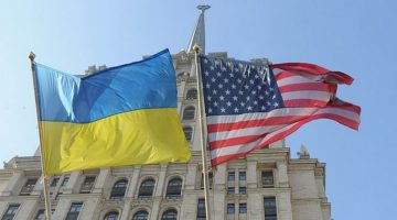 Russia, Moscow. Flag of Ukraine and USA flag against the 'Ukraina' hotel.