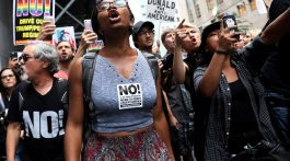Anti-racism protesters shout during protests in front of Trump Tower in New York City, New York, U.S., August 14, 2017.  REUTERS/Shannon Stapleton