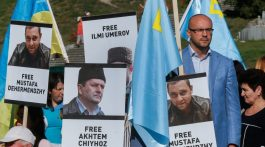 epa05511173 Ukrainian activists hold portraits of jailed people during a rally in support of the Crimean Tatar activist llmi Umerov and all Crimean people jailed by Russia on the Independence Square in Kiev, Ukraine, 26 August 2016. llmi Umerov, the former Deputy Chairman of the Crimean Tatars' self-governing body ?Mejlis? was taken by Russian power into a psychiatric hospital on 18 August 2016. Ilmi Umerov was confined and forced to undergo psychiatric tests, after a Russian court in the annexed Crimea peninsula accused him in a public call to violate the territorial integrity of Russia and public statements opposing Moscow's seizure of the peninsula from Ukraine.  EPA/SERGEY DOLZHENKO
