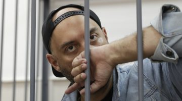 Russian theatre director Kirill Serebrennikov, who was detained and accused of embezzling state funds, looks on inside the defendants' cage as he attends a hearing on his detention at a court in Moscow, Russia August 23, 2017. REUTERS/Tatyana Makeyeva