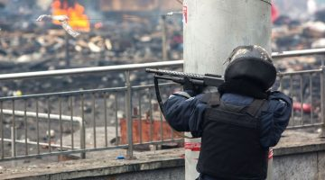 2381826 Ukraine, Kiev. 02/19/2014 A police officer shoots a pump-action and rubber-bullet shotgun on Maidan Nezalezhnosti square in Kiev, where clashes began between protesters and the police. Andrey Stenin/RIA Novosti