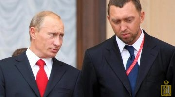 """Russian Prime Minister Vladimir Putin (L) speaks with Oleg Deripaska, head of """"The base element"""" company at the International Investment Forum in Sochi on September 19, 2008. Putin rejected the prospect of a new Cold War with the West and said Russia wanted further integration into the world economy. AFP PHOTO / RIA NOVOSTI / POOL / ILIA PITALEV (Photo credit should read ILIA PITALEV/AFP/Getty Images)"""